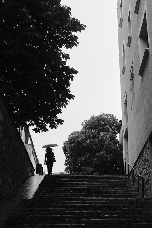 Street photo of a silhouette of a woman