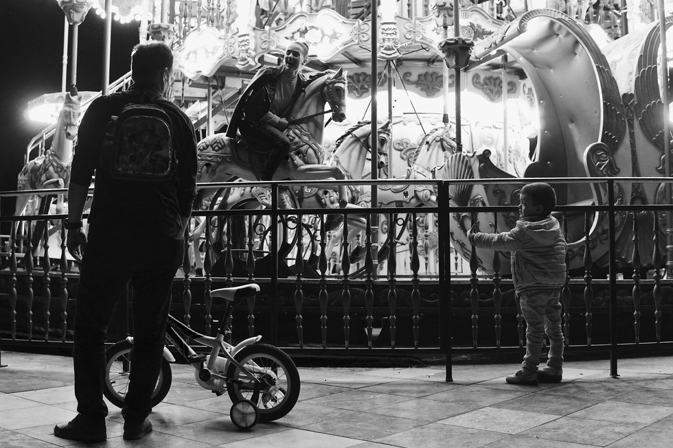 Street photo of a child and a father at