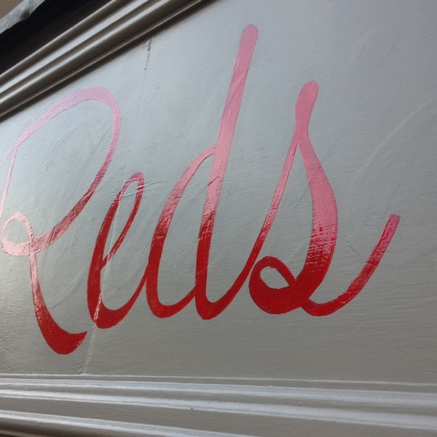 Reds Shop Front Sign
