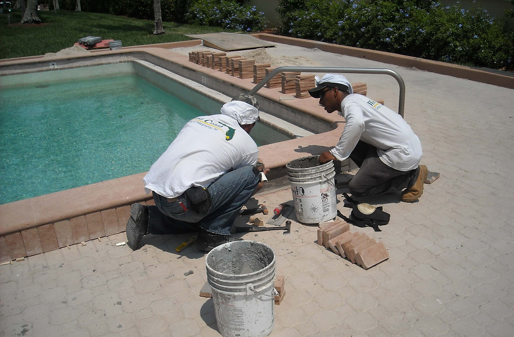 Adding brick pavers to patio beside pool