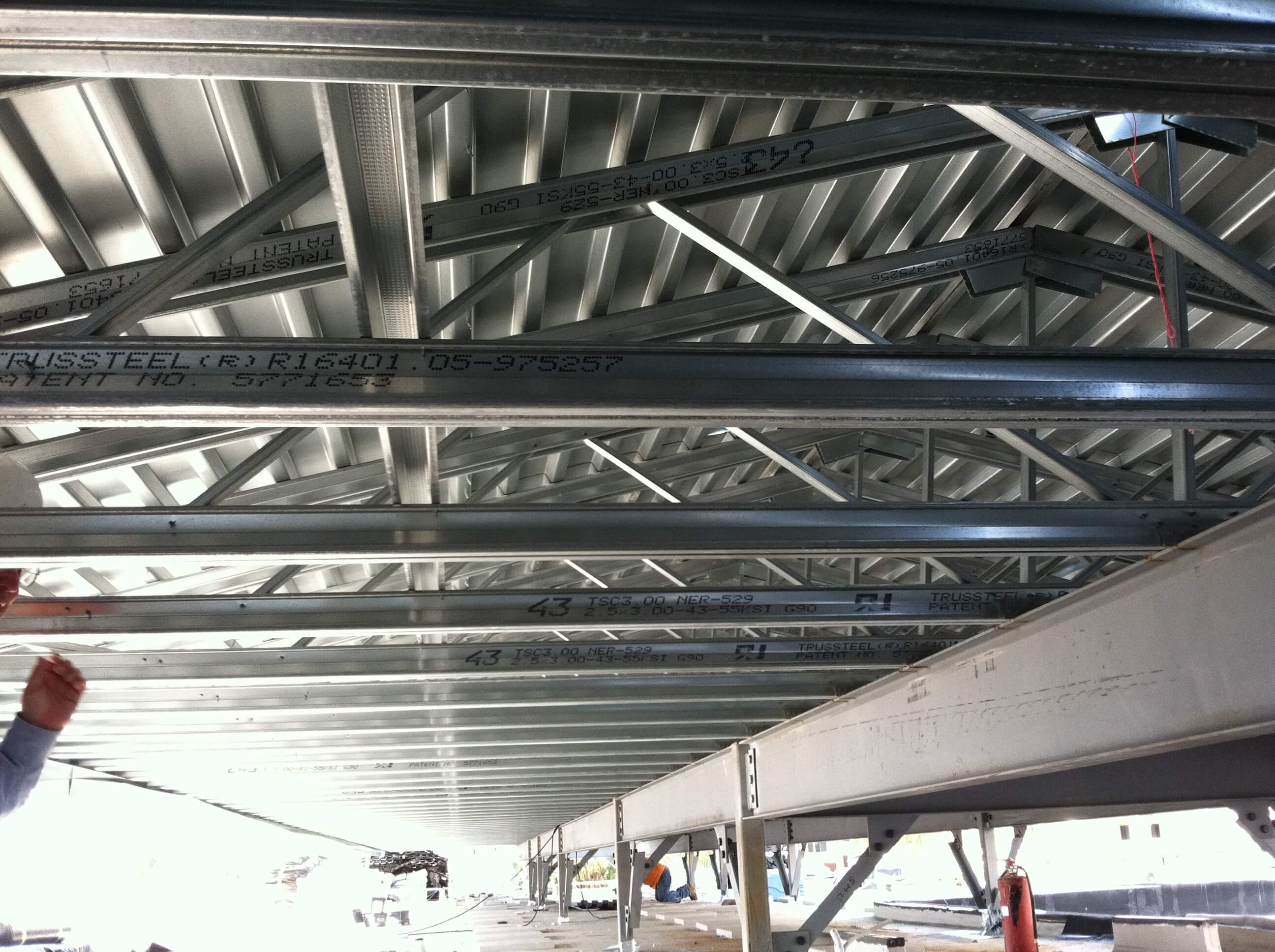 View of steel trusses from interior