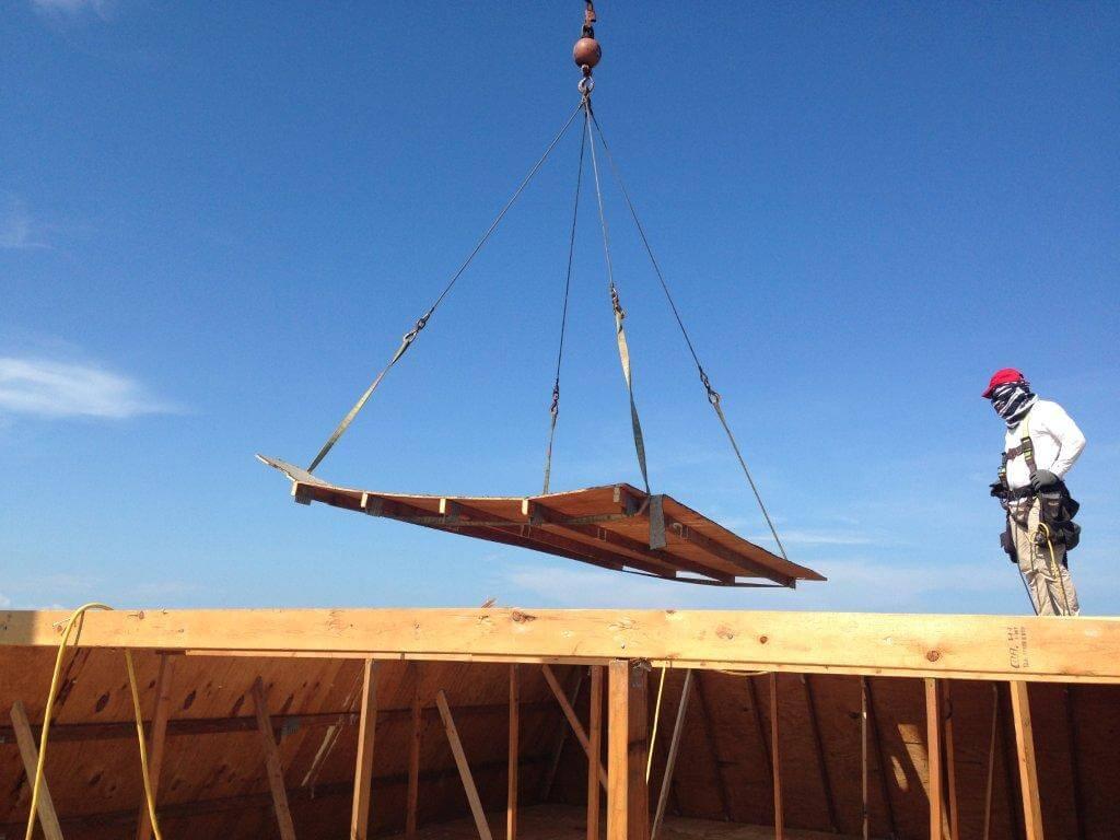 Crane hoists plywood platform