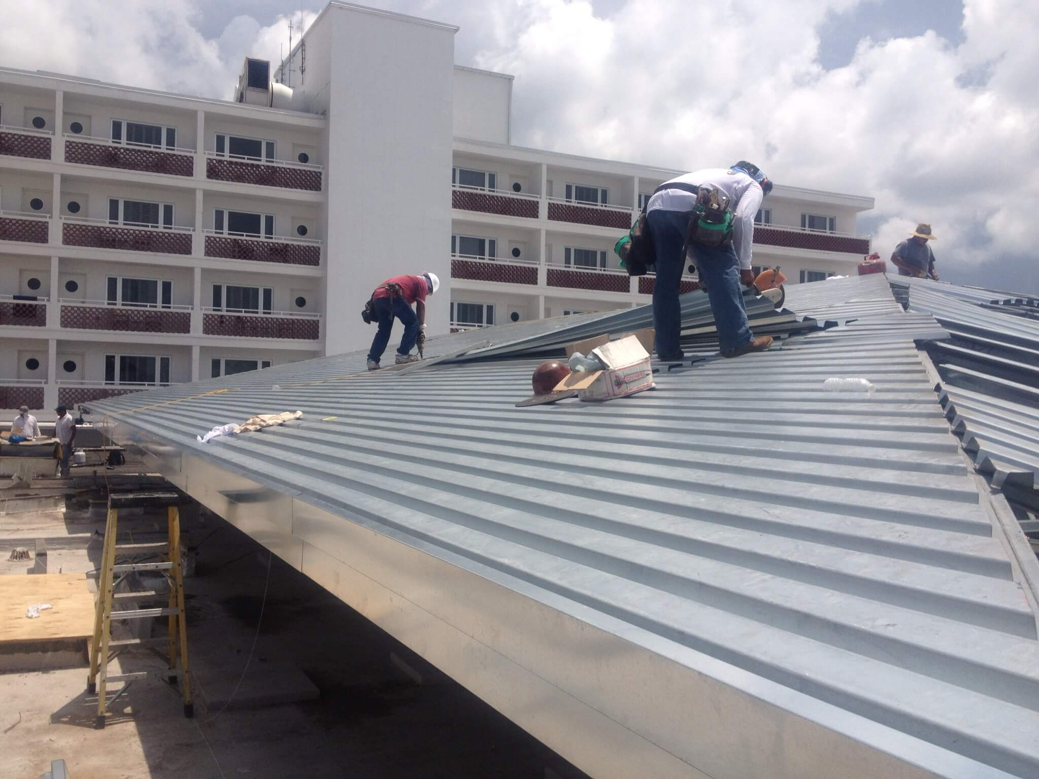WCFE Roofers replacing metal roofing