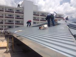 WCFE Roofers replacing metal roofing