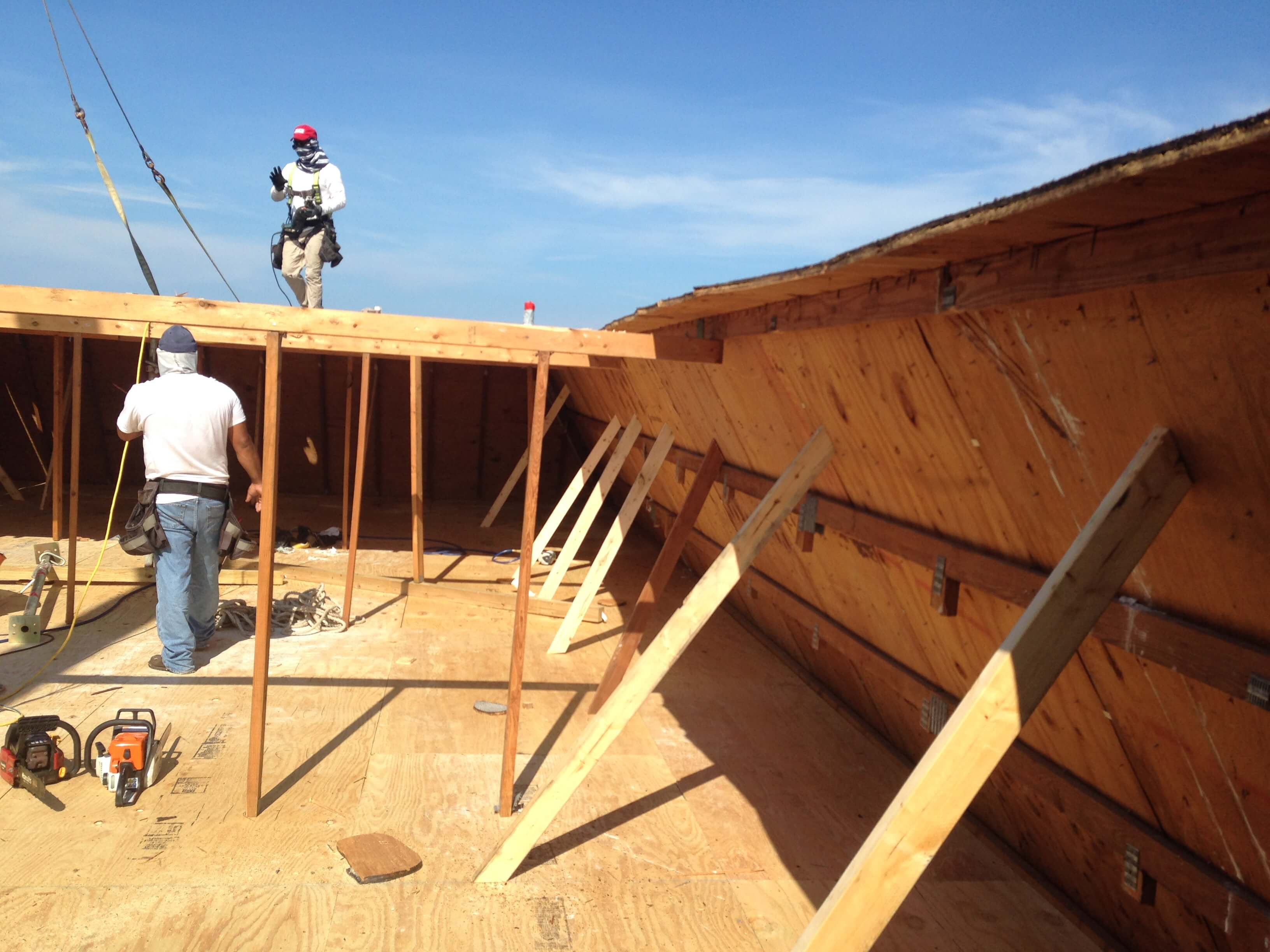 Roofers building wooden structure