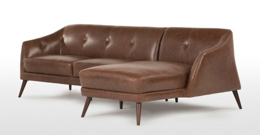 small corner sofa for media room in tan leather. Backdrop dark green walls / gold accents?
