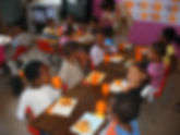 Children taking lunch in their classroom