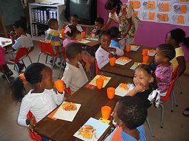 Children taking lunch in their classroom