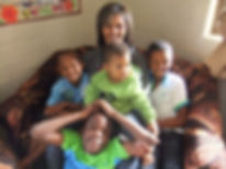 One of the House Mothers with some of the children in her home