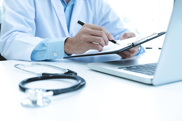 doctor-working-with-laptop-computer-writ