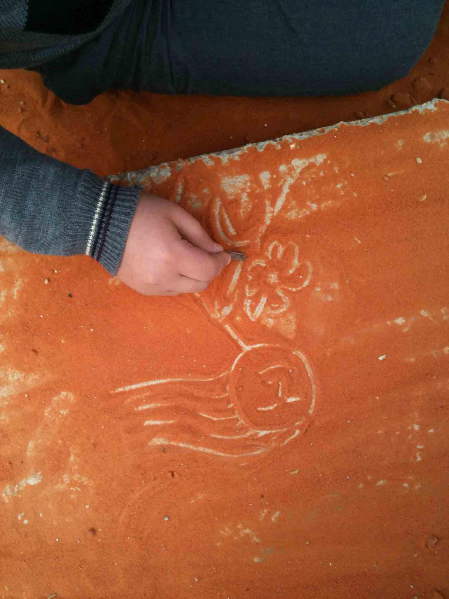 Drawing on sand