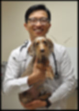 Dr. Choi holding a dog
