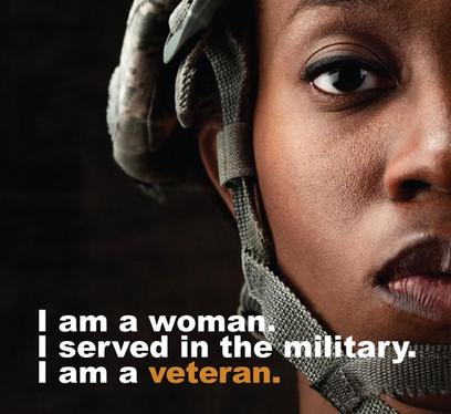 black female veteran in a helmet.jpg