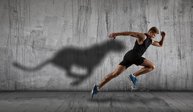 Strong athletic man sprinter, running on