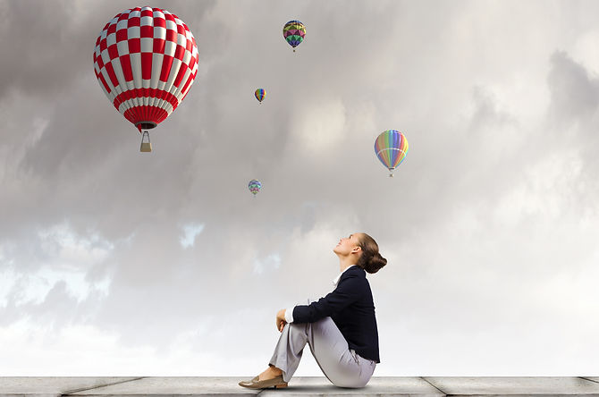 Young%20pretty%20businesswoman%20sitting%20on%20top%20of%20building%20with%20colorful%20balloons%20f