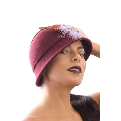 Lilac feather fascinator hat.