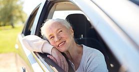 road%20trip%2C%20travel%20and%20old%20people%20concept%20-%20happy%20senior%20woman%20driv