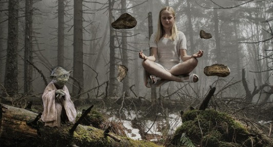 Yoda training a girl who is floating cross legged with four rocks floating beside her