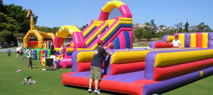 Small gathering with bouncy houses and slides