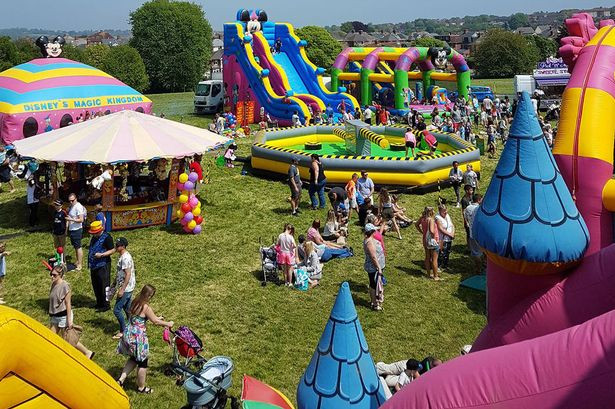 Large gathering with many bouncy castles