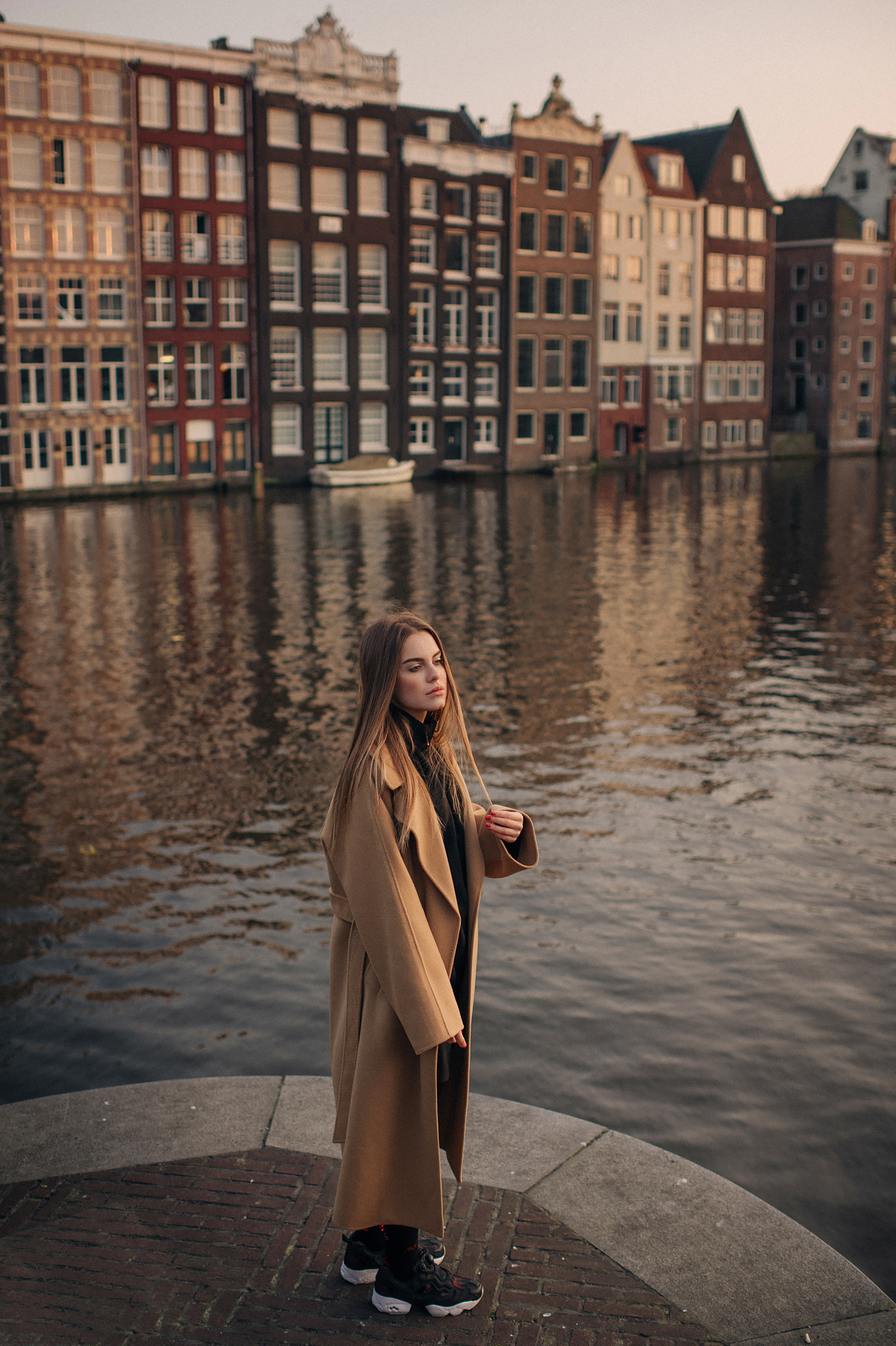 Girl by the canal in Amsterdam