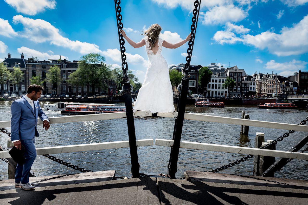 Bride on the canal in Amsterdam