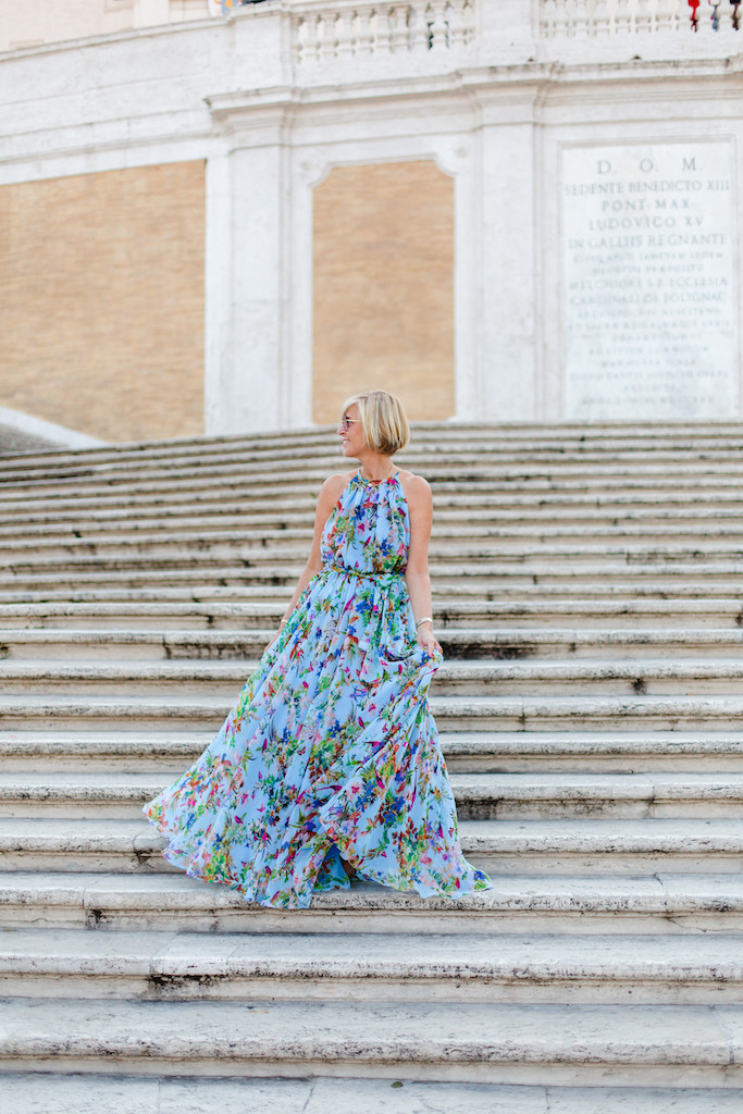 Stylist blogger in a beautiful dress in Rome