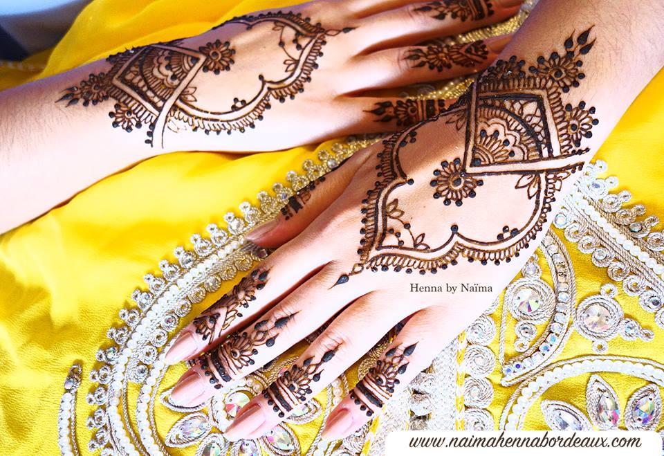 Intricate henna hands