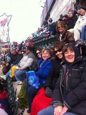 WeCAN volunteers having fun at a Twins game