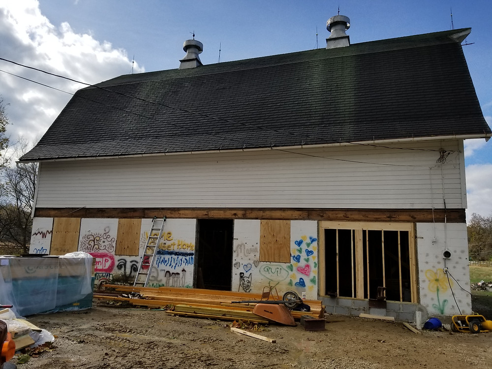 Closing old windows and framing for new windows and new door - Follow the Barn Project.