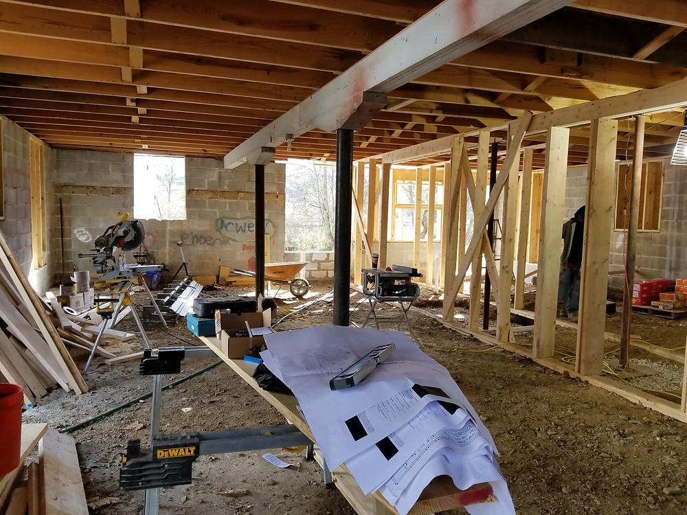Adding structural beams under the existing floor, and new columns to hold the steel beams in place - Follow the barn project