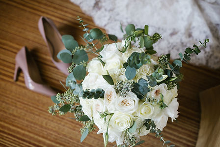 Bridal bouquet of roses and eucalyptus