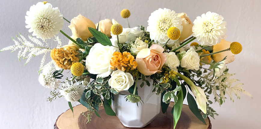 White and yellow floral arrangement
