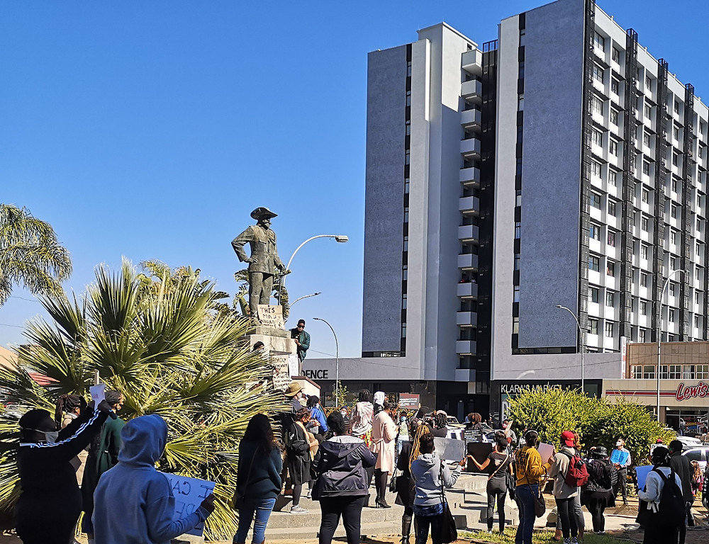 A crowd gathers outside the municipality of Windhoek with placards to protest the continued existence of the Curt von Francois statue. Von Francois was known for his brutality during the colonial regime.