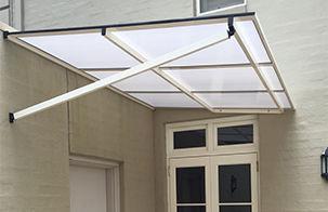 Polycarbonate awning over door, fixed door awning, carbolite window awning, awning over deck
