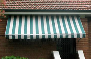 striped awning over balcony, window shade awning, retractable awning, motorised awning
