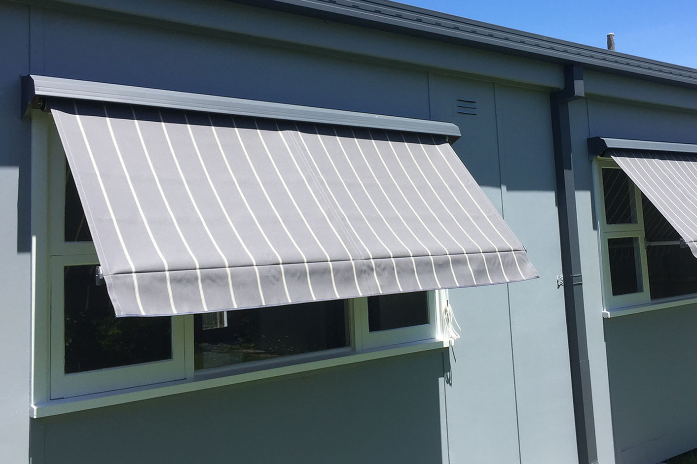 Old fashioned convertible window awnings