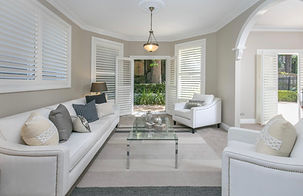 timber window shutters in a lounge room, white plantation shutters, timber shutter in Northbridge