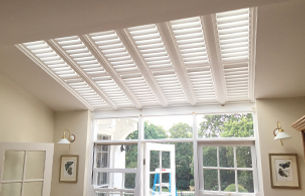 Skylight shutters in a conservatory ceiling, timber shutters, plantations shutters in a skylight, bedroom shutters, shutters sydney