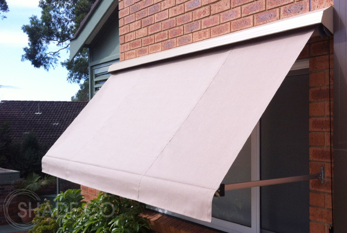 Retractable pivot arm awning with hood custom made