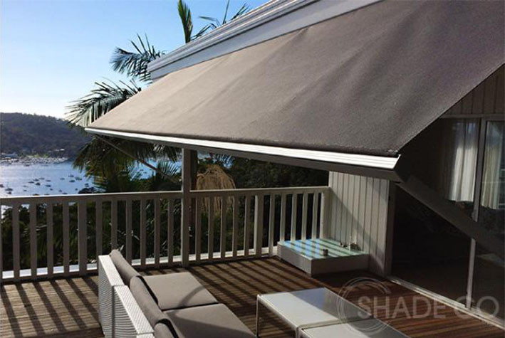 retractable awning shading entertainment area