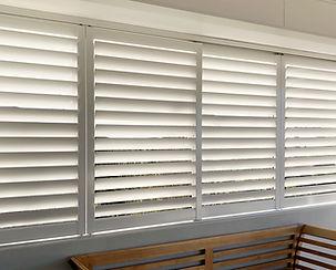 aluminium shutters enclosing a deck, external shutters, privacy screens sydney, custom made aluminium shutters
