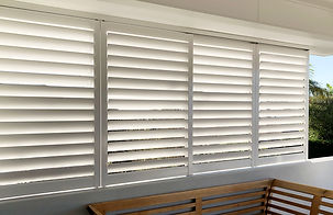 Aluminium shutters enclosing balcony, sliding aluminium shutters, outdoor shutters, aluminium privacy screen to screen neighbours house