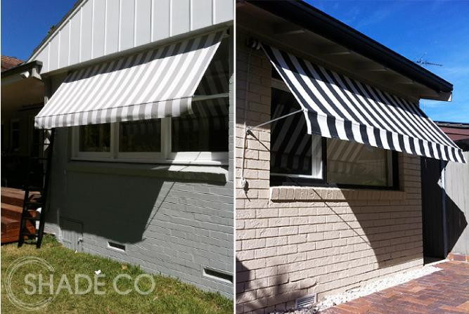 Striped pivot arm awnings over windows