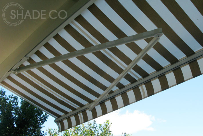 Folding arm awning with natural striped canvas