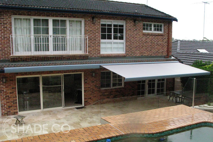 Folding arm awning over patio area