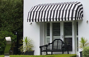 Fixed canopy awning ove door, black and white stripe door awning, garden chair with awning