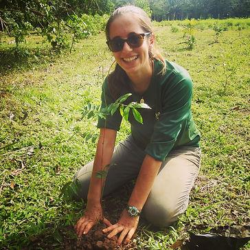 Hilary Brumberg planting tree riparian r