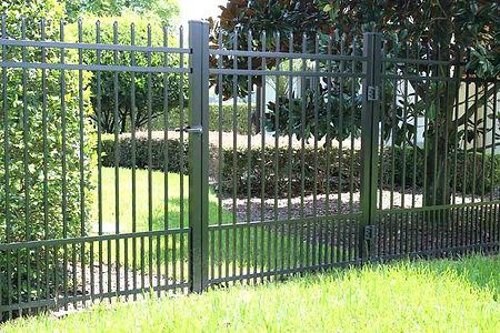 black-ornamental-aluminum-fence-puppy-pi