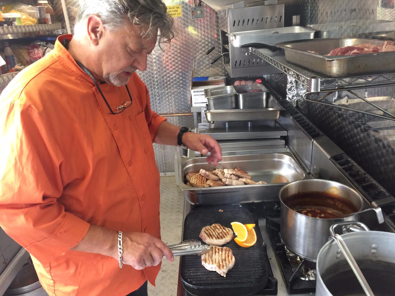 ian preparing food on film location